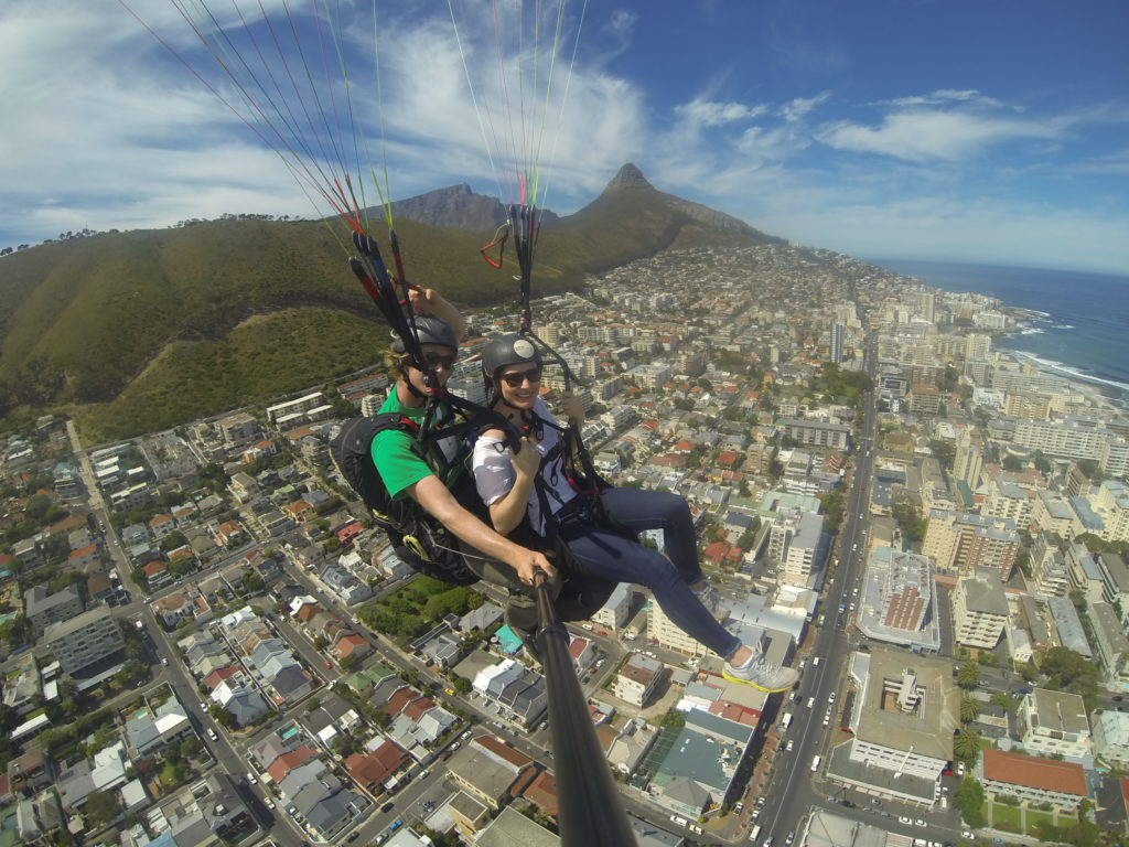Paragliding over Seapoint with Signal Hill in the background