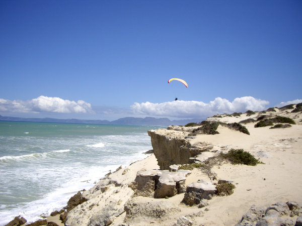 Tandem Paragliding above cliffs at Macassar, Cape Town