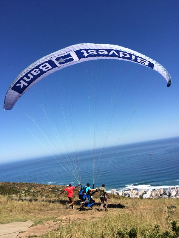 Launching from Signal Hill with Bidvest Bank branded paragliders